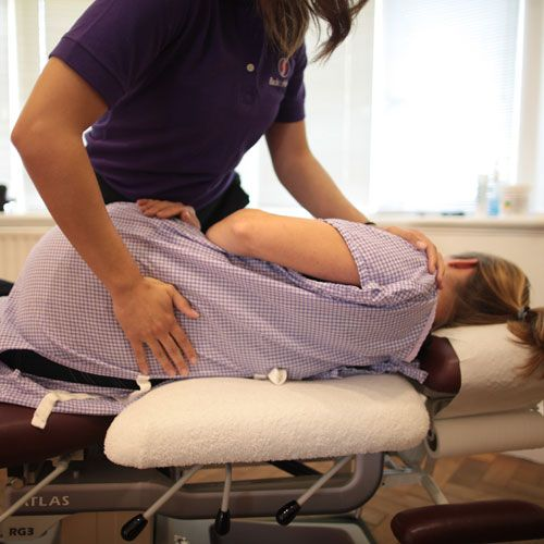 Patient receiving treatment for lower back pain in Wrexham